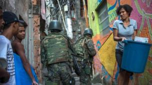 Members of the police and the armed forces take part in an operation to fight heavily-armed drug traffickers at the Rocinha favela in Rio de Janeiro, Brazil, on September 22, 2017