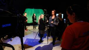 BBC Reporter Aileen Moynagh demonstrates how it's done for our Young Reporters