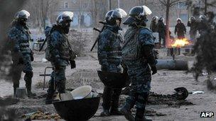 Riot police patrolling the Kazakh town of Zhanaozen following riots in December 2011
