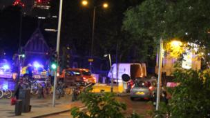 The white van, in the centre of this photo, is believed to have been used in the attack on London Bridge