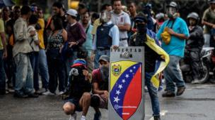 Demonstrators block an avenue during an anti-government protest in Caracas on June 29, 2017