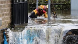 Fast flowing water caused havoc to some homes, and emergency services had to work overnight to clear flooded drains in Stalybridge, Greater Manchester.