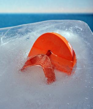 A flip flop frozen in ice