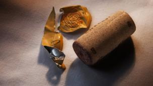 A wine cork and wrapper