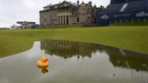 Rubber duck sits on a big puddle at St Andrews