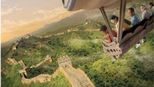 Computer generated image of a family on a ride, soaring above a panorama of the Great Wall of China.