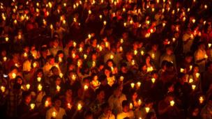Indonesian Christians attend a Christmas Eve service at a church in Surabaya, East Java province, on 24 December, 2016