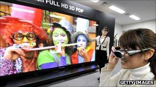 woman watches 3D TV