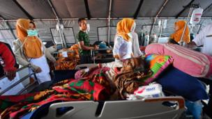 Patients receive medical help at a makeshift ward set up outside the Moh. Ruslan hospital in Mataram