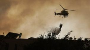 A helicopter fights a forest fire in Vila Cha, Lousa, Portugal, 15/10/2017