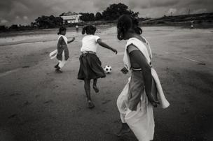Girls chase a football in a tiny village called Khunti in the state of Jharkhand. F