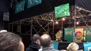 People watching rugby