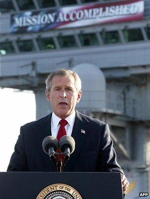 """US President George Bush addresses the nation on Iraq beneath a banner reading """"Mission Accomplished"""" aboard the nuclear aircraft carrier USS Abraham Lincoln on 30 April 2003"""