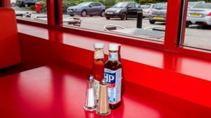 Condiments on tha table at Little Chef. Doncaster, Downtown Yorkshire.