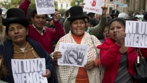 """Aymara women and activists shout slogans and hold signs that read in Spanish """"not one less"""" during a march against gender violence in La Paz, Bolivia, Wednesday, Oct 19, 2016"""