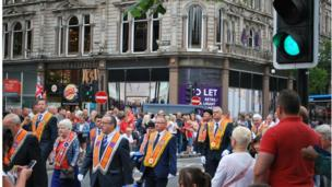 Orangemen and band members march in Belfast