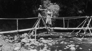 Princess Elizabeth and the Duke of Edinburgh admiring the view from a bridge in the grounds of Sagana Lodge, their wedding present from the people of Kenya. 5 February 1952: