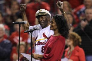 Singer Chuck Berry and his daughter Ingrid perform the national anthem before the St. Louis Cardinals play the Milwaukee Brewers on 14 October, 2011 in St Louis, Missouri.