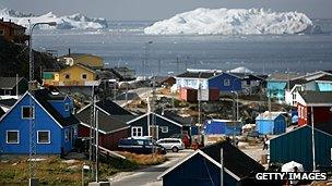 Town and iceberg in Greenland