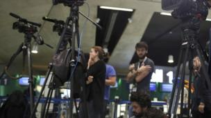 Television crews wait near the EgyptAir desk at Charles de Gaulle airport, after an EgyptAir flight disappeared from radar during its flight from Paris to Cairo, in Paris, France, 19 May, 2016.