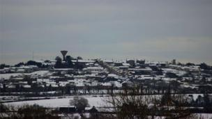 Rathfriland on the hill, in the snow, by Andrew McCracken