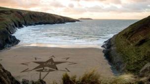 David Bowie Blackstar album logo on the sands at Mwnt beach