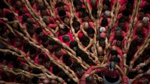 "Members of ""Vella de Xiquets de Valls"" form their human tower during the 26th Human Tower Competition in Tarragona, Spain, on Sunday, Oct. 2, 2016."