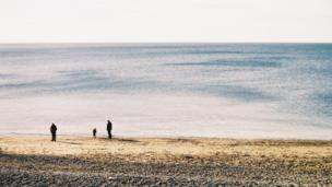 Ramy Elabbadi took this photo from Aberystwyth prom of walkers out for an early afternoon stroll