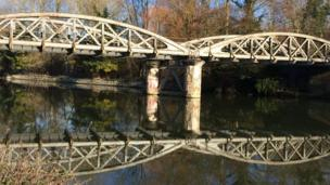 This picture captured the reflection of a railway bridge at Kennington this week