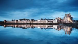 Caernarfon Castle reflecting in the water