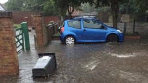 Felicity Baker pictured the flooding outside her house in Hertfordshire