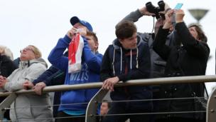 This spectator brought a pair of binoculars to ensure he got a close-up view