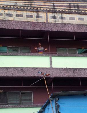 Sabir in the block of flats where he lives