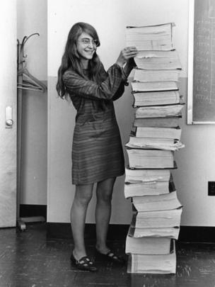Margaret Hamilton with a stack of code