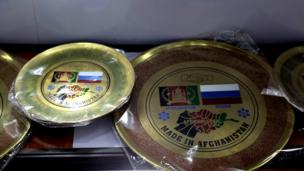 A reminder of recent history: Bronze souvenir plates, celebrating friendship between Russia and Afghanistan