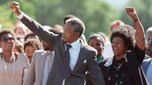 ANC leader Nelson Mandela and wife Winnie raise fists upon his release from Victor Verster prison in Paarl on 11 February 1990