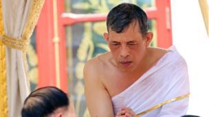 A Royal Household Bureau handout photo shows Thai King Maha Vajiralongkorn Bodindradebayavarangkun bathing with sacred water during the royal purification ablution bath