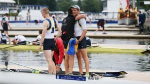 Crew from the University of Bath congratulate each other after winning their race.