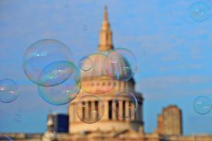 Bubbles float across the sky as St Paul's is seen in the background