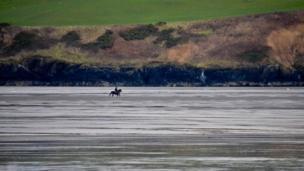 Horse rider on Poppit Sands, Pembrokeshire.