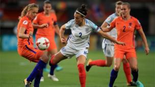 "Netherland""s Anouk Dekker (left) and England""s Lucy Bronze (centre) battle for the ball"