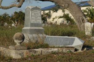 Two gravestones, one fallen over
