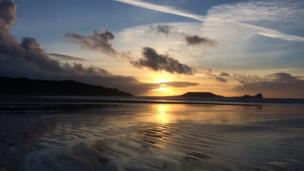 As Christmas dawns...Bethan Davies captured the calm before Storm Barbara on Rhosilli beach, Gower, for our Pic of the Day