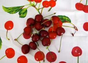 Cherries on a tablecloth