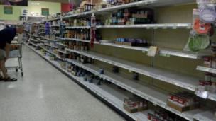 Soup shelves are almost empty in a super market