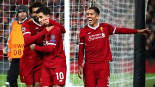 Philippe Coutinho of Liverpool celebrates after scoring his sides fifth goal with Mohamed Salah of Liverpool and Roberto Firmino of Liverpool during the UEFA Champions League group E match between Liverpool FC and Spartak Moscow at Anfield on December 6, 2017 in Liverpool
