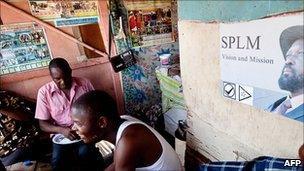 Men listen to Radio Miraya in Juba
