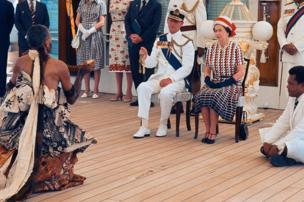 Queen Elizabeth ll and Prince Philip, Duke of Edinburgh receive and are entertained by Fijian folk and traditional dancers on board the Royal Yacht Britannia on 16 February 1977 in Fiji.