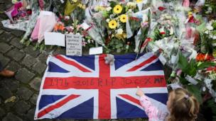 Flowers are left close to where the MP Jo Cox was killed on 17 June 2016 in Birstall, United Kingdom.