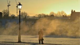 Pedestrian in mist in London